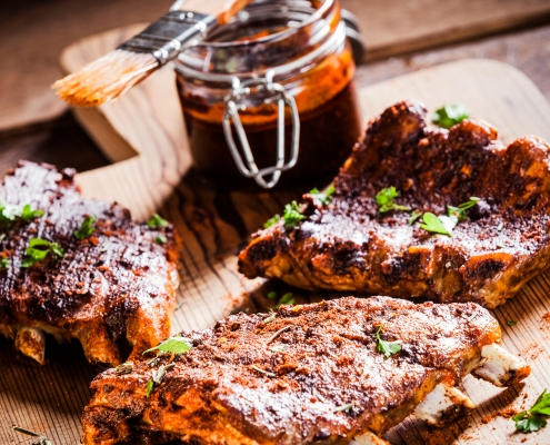 Barbecued ribs in a marinade
